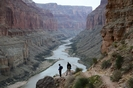 Two men enjoying the view from just below the Nankoweep Graineries in Grand Canyon