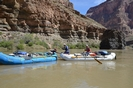 Raft floating past Vulcan's Anvil in the Grand Canyon