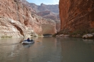 Whitewater raft floating toward Redwall Cavern in Grand Canyon