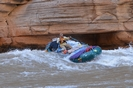 Whitewater raft running Upset Rapid on the Colorado River