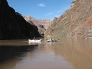 Raft floating down the Colorado River above Hermit Rapid
