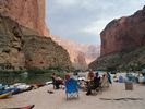 A rafting trip campsite with a spectacular backdrop of the Grand Canyon