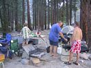 A rafting group preparing a meal at Survey Creek Camp on the Middle Fork of the Salmon