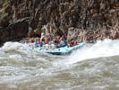 Commercial raft running the left side of Crystal Rapid in the Grand Canyon