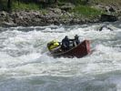 TWo men in a red dory going sideways in Big Mallard rapid, Main Salmon River