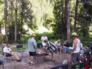 A rafting party gathered around a BBQ on the Middle Fork of the Salmon