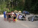 Group gathered around a table at a rafting campsite on the Main Salmon